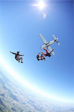 Skydivers free falling above Leutkirch, Bavaria, Germany Stock Photo - Premium Royalty-Free, Code: 649-07238945
