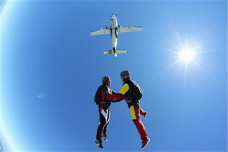 Female skydivers free falling above Leutkirch, Bavaria, Germany Stock Photo - Premium Royalty-Free, Code: 649-07238948