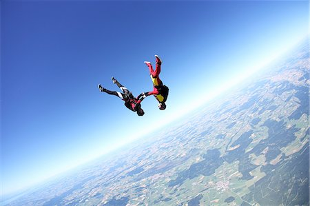 Female skydivers upside down above Leutkirch, Bavaria, Germany Stock Photo - Premium Royalty-Free, Code: 649-07238949