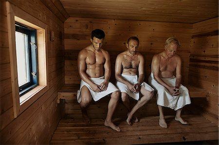 Three men sitting in sauna with heads bowed Stock Photo - Premium Royalty-Free, Code: 649-07238960
