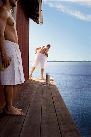 Two men standing outside sauna Stock Photo - Premium Royalty-Free, Code: 649-07238976