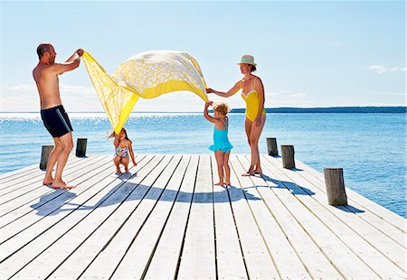 family  fun  outside - Parents and two young girls playing on pier, Utvalnas, Gavle, Sweden Stock Photo - Premium Royalty-Free, Code: 649-07238987
