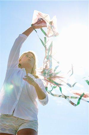 Young woman holding kite, Utvalnas, Gavle, Sweden Stock Photo - Premium Royalty-Free, Code: 649-07239004