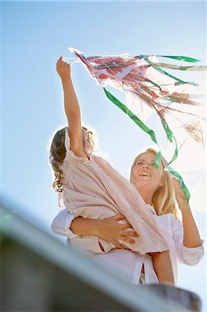 Mother and daughter playing with kite, Utvalnas, Gavle, Sweden Stock Photo - Premium Royalty-Free, Code: 649-07239005
