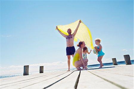 Young family on pier, Utvalnas, Gavle, Sweden Stock Photo - Premium Royalty-Free, Code: 649-07239014