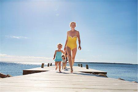 Family walking on jetty, Utvalnas, Gavle, Sweden Stock Photo - Premium Royalty-Free, Code: 649-07239016