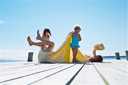 european - Young family fooling around on pier, Utvalnas, Gavle, Sweden Stock Photo - Premium Royalty-Free, Code: 649-07239013