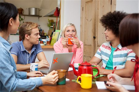 studying (all students) - Flatmates planning around kitchen table Stock Photo - Premium Royalty-Free, Code: 649-07239136