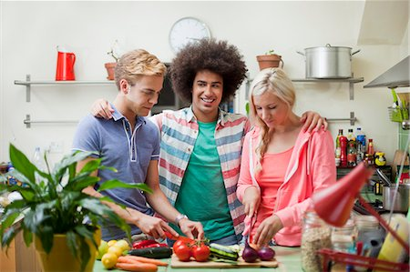 Friends preparing vegetables in kitchen Stock Photo - Premium Royalty-Free, Code: 649-07239130