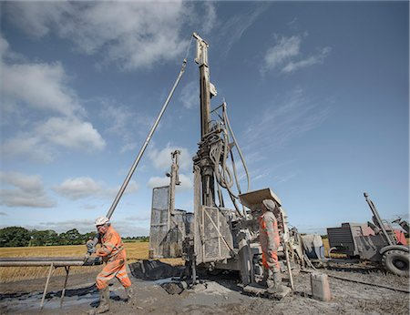 drilling - Workers operating drilling rig to explore for coal in field Stock Photo - Premium Royalty-Free, Code: 649-07239185