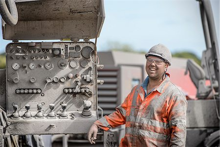 drilling - Drilling rig worker in hard hat and workwear, smiling Stock Photo - Premium Royalty-Free, Code: 649-07239187