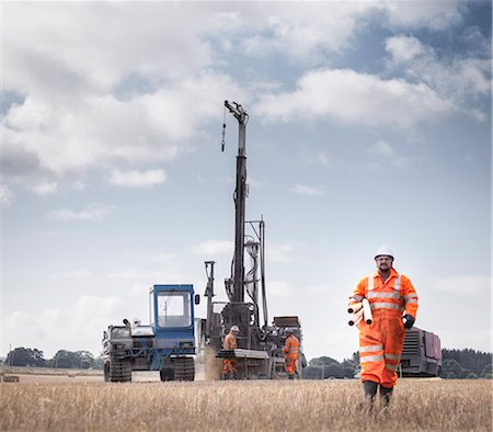 drilling - Workers and drilling rig exploring for coal in field Stock Photo - Premium Royalty-Free, Code: 649-07239188
