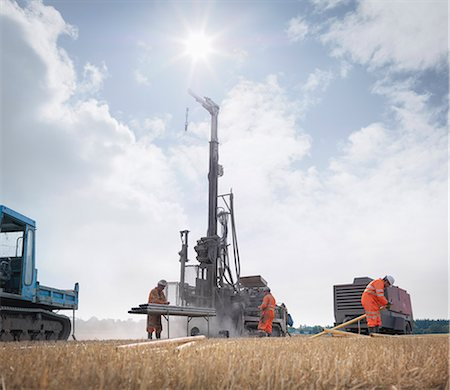 drilling - Workers and drilling rig exploring for coal in field Stock Photo - Premium Royalty-Free, Code: 649-07239189