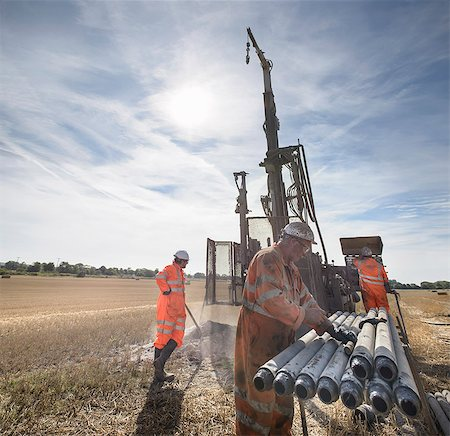 Workers operating drilling rig in field Stock Photo - Premium Royalty-Free, Code: 649-07239201
