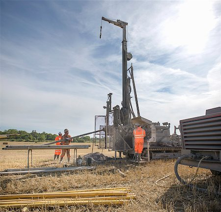 people working coal mines - Small team of workers operating drilling rig in field Stock Photo - Premium Royalty-Free, Code: 649-07239203
