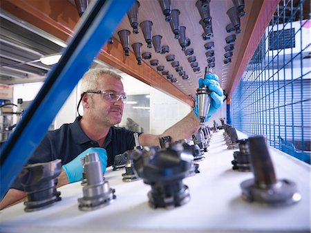 people working in factory - Engineer selecting lathe cutting tools in factory Stock Photo - Premium Royalty-Free, Code: 649-07239226