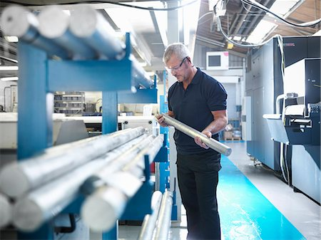people working in factory - Engineer working with aluminium in factory Stock Photo - Premium Royalty-Free, Code: 649-07239220