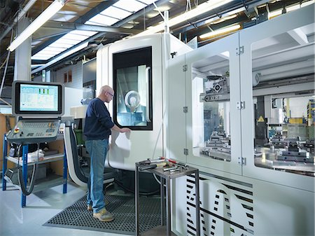 people working in factory - Engineer at computer numerical controlled lathe (CNC) in factory Stock Photo - Premium Royalty-Free, Code: 649-07239237
