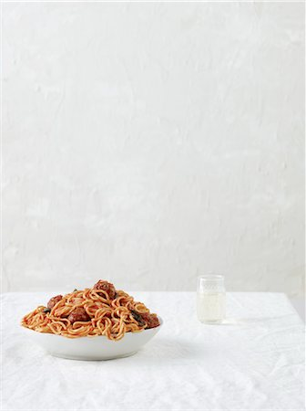 Still life with spaghetti and meatballs with white wine Stock Photo - Premium Royalty-Free, Code: 649-07239249