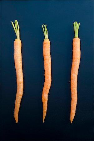 Three carrots, still life Stock Photo - Premium Royalty-Free, Code: 649-07239337
