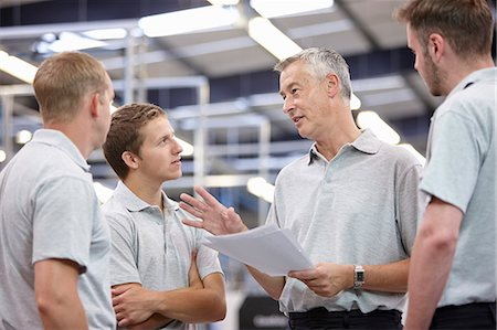 Manager and workers meeting in engineering factory Stock Photo - Premium Royalty-Free, Code: 649-07239342