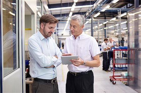 decision - Manager and worker looking at digital tablet in engineering factory Stock Photo - Premium Royalty-Free, Code: 649-07239355