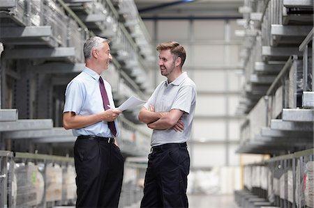 Worker and manager checking orders in engineering warehouse Stock Photo - Premium Royalty-Free, Code: 649-07239376