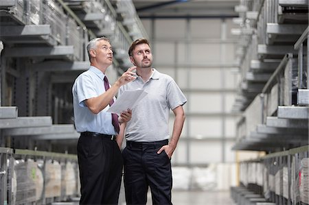 Worker and manager checking products in engineering warehouse Stock Photo - Premium Royalty-Free, Code: 649-07239377