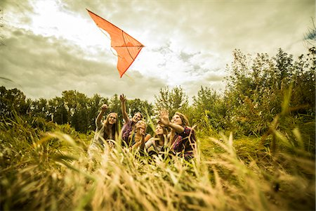 Five young women having fun with kite in scrubland Stock Photo - Premium Royalty-Free, Code: 649-07239408