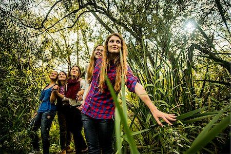 Five young women exploring marshland Stock Photo - Premium Royalty-Free, Code: 649-07239412
