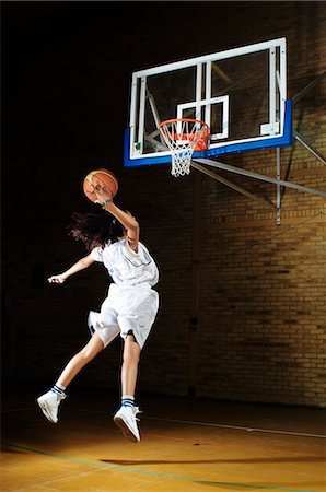 Basketball player aiming at hoop Stock Photo - Premium Royalty-Free, Code: 649-07239508