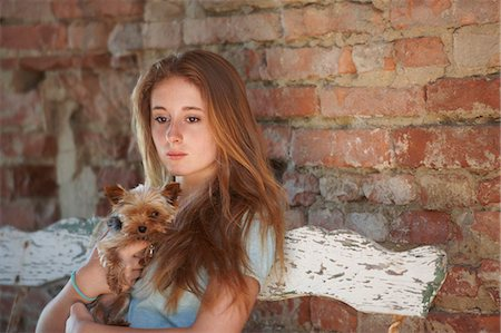 Teenage girl on bench with dog Stock Photo - Premium Royalty-Free, Code: 649-07239596