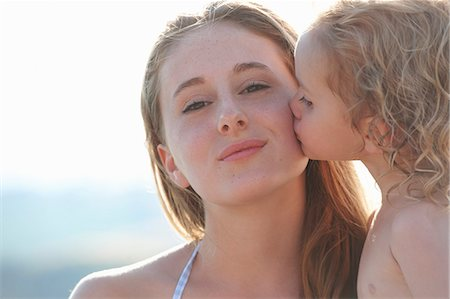 Portrait of young girl kissing older sister Stock Photo - Premium Royalty-Free, Code: 649-07239591