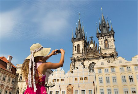european (places and things) - Teenage girl photographing Our Lady of Tyn church, Prague, Czech Republic Stock Photo - Premium Royalty-Free, Code: 649-07239630