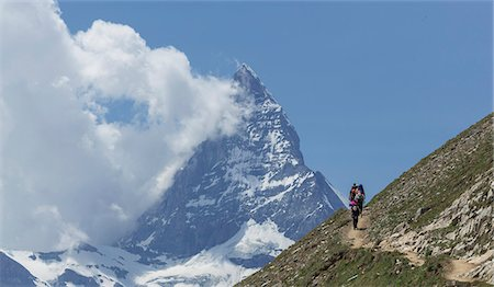 snow capped - Man hiking towards the Matterhorn, Zermatt, Canton Wallis, Switzerland Stock Photo - Premium Royalty-Free, Code: 649-07239633