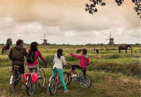 farming (raising livestock) - Family with two children on bikes, Kinderdijk, Olanda, Amsterdam Stock Photo - Premium Royalty-Free, Code: 649-07239645