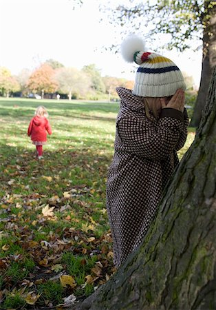 Girls playing hide and seek in park, London, England, UK Stock Photo - Premium Royalty-Free, Code: 649-07239652