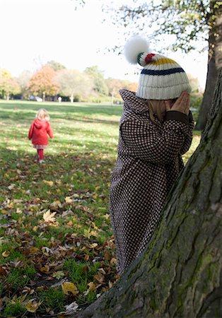 Girls playing hide and seek in park, London, England, UK Stock Photo - Premium Royalty-Free, Code: 649-07239652