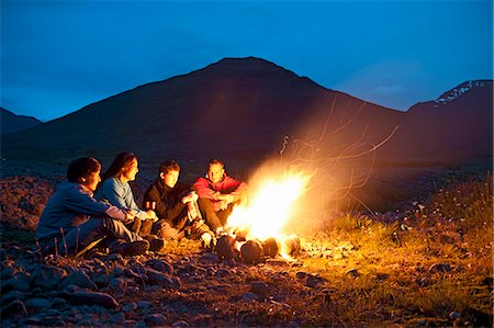 Group sitting at campfire, Eyjafjordur, North Iceland Stock Photo - Premium Royalty-Free, Code: 649-07239669