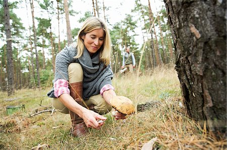 Mid adult woman foraging for mushrooms Stock Photo - Premium Royalty-Free, Code: 649-07239741
