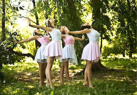 Four young ballet dancers performing in woods Stock Photo - Premium Royalty-Free, Code: 649-07239876