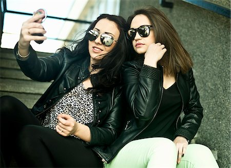 style - Two young woman making self portrait on mobile phone Stock Photo - Premium Royalty-Free, Code: 649-07239872