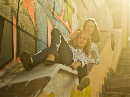 Two young women reclining on stairway Stock Photo - Premium Royalty-Free, Code: 649-07239890