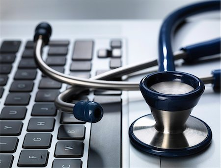 selective focus computer no people - Stethoscope sitting on laptop illustrating online healthcare and doctor's desk Stock Photo - Premium Royalty-Free, Code: 649-07279536