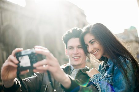 people and vacation - Young couple photographing themselves Stock Photo - Premium Royalty-Free, Code: 649-07279664