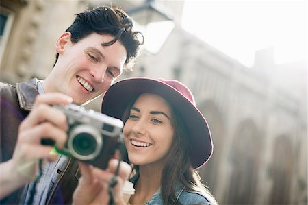 people and vacation - Young couple with vintage camera Stock Photo - Premium Royalty-Free, Code: 649-07279662