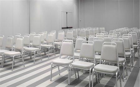 White chairs in empty auditorium Stock Photo - Premium Royalty-Free, Code: 649-07279695