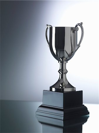 Trophy against black and white background Stock Photo - Premium Royalty-Free, Code: 649-07279757