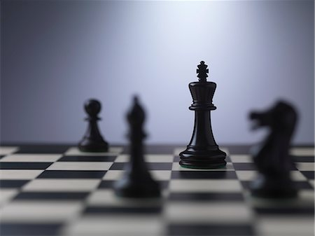 strategy - Chess pieces on a board showing king Stock Photo - Premium Royalty-Free, Code: 649-07279759