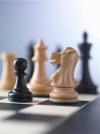 strategy - Chess game, player preparing to check mate Stock Photo - Premium Royalty-Free, Code: 649-07279760